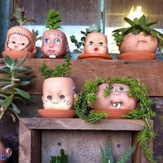 DIY Baby Doll Head Flower Pots..Hmm..this is kinda scary, not cute, if thats what they were going for..lol.
