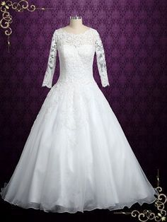 Gorgeous long sleeves lace wedding dress, fabricated with organza and satin, finished with a beautiful lace keyhole back. Photoed in ivory. This dress can also be made in all white. Working Time: 8-10