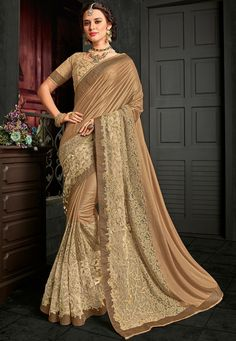 Simple and classy in design, this stunning golden and beige color lycra pattern wedding wear saree is worth investing in. Featuring an interesting pattern all over, this saree will amplify your look instantly. Buy Designer Sarees Online, Party Wear Sarees Online, Saree Shopping, Indian Beauty Saree, Indian Sarees, Silk Sarees, Stylish Sarees, Latest Sarees, Fancy Sarees