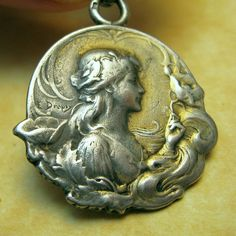 Antique Art Nouveau French Silver DROPSY WOMAN & Poppy FLOWERS Charm Pendant #mileDropsy #ArtNouveau Poppy Flowers, Vintage Necklaces, Art Nouveau Jewelry, Antique Art, Pocket Watch, Poppies, Coins, Charms, Gems