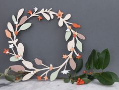 Anna Wiscombe's laser-cut wood wreath is lightweight (read: easy to hang) and lasts basically forever. #etsy