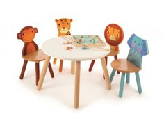 This children's table will be a hit with all safari fans. The sturdy design and intricate animal drawings make it a charming addition to any bedroom, playroom, or even kitchen. They'll love eating, playing or colouring at the Safari table, with matching a Kids Table And Chairs, Kid Table, Table And Chair Sets, Wooden Childrens Table, Wooden Tables, Wooden Toys, Motif Jungle, Safari Bedroom, Kids Playroom Furniture
