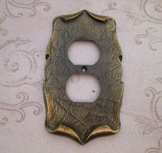 cute vintage 1970s metal cast electrical outlet plate cover - Amerock Carriage House - - one original mounting screw included -  Size - 5.5 tall x