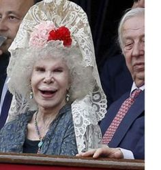 the Duchess of Alba...reputed to be the richest woman in the world...gee, think she could afford better cosmetic surgeons...or just give it up...!