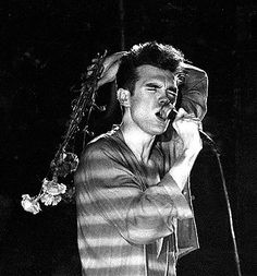 Morrissey on stage with The Smiths at Sheffield City Hall, Sheffield, England on March 1984 – photo by Michael Powell. The Smiths Morrissey, Johnny Marr, Little Charmers, Simon Garfunkel, Sad Movies, Charming Man, Music Icon, Post Punk, Musicals