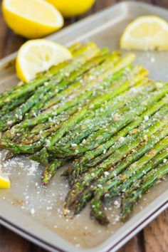 This Roasted Lemon Parmesan Asparagus is a simple and easy side dish that& packed with flavor. Fresh asparagus is roasted to perfection and season with lemon juice and Parmesan cheese. You can have this vegetable prepped and ready to be devoured in Veggie Side Dishes, Vegetable Sides, Side Dishes Easy, Food Dishes, Vegetable Thanksgiving Side Dishes, French Side Dishes, Healthy Recipes, Side Dish Recipes, Veggie Recipes