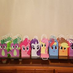 Another happy customer who shared her assembled 'My Little Pony' Party Favor Bags picture with the templates she bought from us. Visit our website to learn more about our printable templates. My Little Pony Party Favor Bags. My Little Pony Birthday Party ideas. My Little Pony Party decorations. My Little Pony Treat bags/ Goody bags/ Loot Bags/ Candy Bags/ Favor bag/ Party favors. My Little Pony cake/ invite/ invitations/ banner/ DIY Party bags