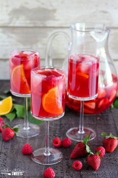 Strawberry Sangria - White wine or rosé, flavored with fresh strawberries, raspberries, oranges, and homemade strawberry syrup.