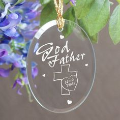 """Engraved Godfather Oval Glass #Christmas Tree Ornaments. Create a lasting Godfather Gift she will cherish for a lifetime with our Personalized Godfather Ornament. A beautiful gift to celebrate the joy & love he brings into your life every day. This beautifully engraved ornament also looks stunning hanging in the window catching the morning sunshine. Each Godfather Keepsake Ornament measures 3.75"""" x 2.75"""" and includes a golden ribbon"""