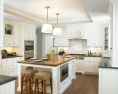 chamfered legs home design ideas pictures remodel decor large traditional shaped open concept kitchen idea manchester
