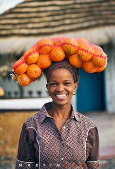 This is a portrait of a typical South African women coming home from the market, most women are very conservative in the way they dress and act. The women are the people who run the home and keep the family together