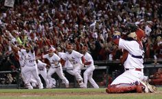 Yadier Molina celebrates after the final out of the 2011 World Series!