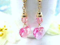 This is a pair of romantic pink heart Swarovski crystal Valentines dangle earrings that is part of my Valentines Day collection! This pink sparkly Swarovski crystal heart is a beautiful Valentine color! There is a 4 mm rose pink micro-faceted round Swarovski crystal above the heart crystal along with a 4mm gold filled rondelle and a faceted 3mm gold filled bead connecting the crystal heart to the gold filled ball french earring hooks. I used tarnish resistant gold filled wire to make these…