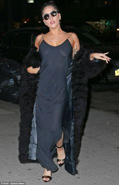 Dare to bare arms in a strappy blue slip dress like Gaga. Similar: Amanda Uprichard Gold Ball Slip Dress at Revolve, now $78