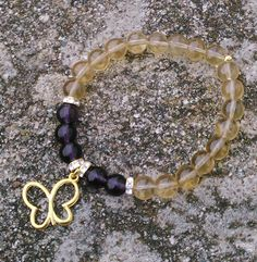 Toremore Crafts - amethyst and amber glass bead bracelet with golden butterfly charm