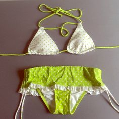 Green and white polka dot string/ skirt bikini Green and white polka dot bikini. Top is medium. Bottoms are a xs. Strings on both. The bottoms are a different style but it's actually a sexy bottom style. Looks like a short  skirt from the front. Different but very cute only worn twice. No holes or stains. Top has removable padding Victoria's Secret Swim Bikinis