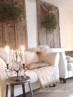 Old doors as wall art with rustic wreaths, this is gorgeous!