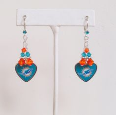 Miami Dolphins Earrings, Football is the Heartbeat of Miami, Orange and Teal Crystal Leverback Fins Earrings by scbeachbling on Etsy