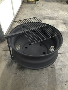 """25"""" semi wheel fire pit with pivoting grill"""