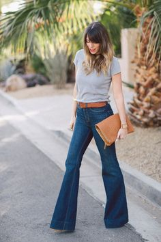 Trend alert: flared denim. Wear them to work with a blouse and blazer or go casual with platform wedges and a basic grey T-shirt.