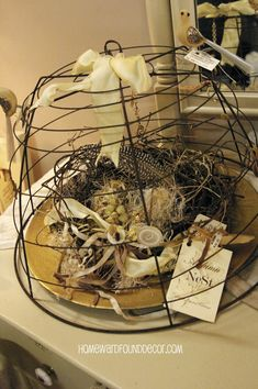 Here's a 'Fast, Cheap & Easy' TM decorating idea that brings the beauty of nature indoors: a dome made from a wire garden planter! I...