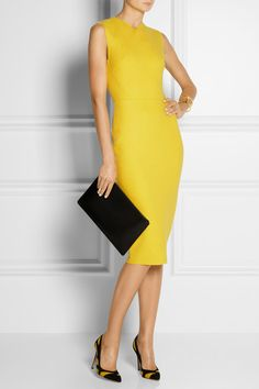 Victoria Beckham   Wool-blend felt sheath dress  $2,150  Fall is no time to shy away from bold color - make a statement in Victoria Beckham's perfectly tailored dress. What we really love about this wool-blend felt dress is the universally flattering fit and length. Leave the two-way zip fastening open a few inches from the bottom to create a back vent.   Shown here with: Maiyet cuff, Maria Black bracelet, Maison Martin Margiela ring and ring, Gianvito Rossi shoes, Jil Sander clutch.