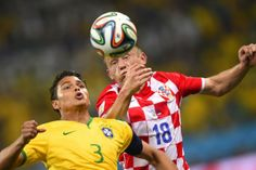 Brazil\'s defender and captain Thiago Silva (L) and Croatia\'s forward Ivica Olic vie for the ball during a Group A football match between Brazil and Croatia at the Corinthians Arena in Sao Paulo during the 2014 FIFA World Cup on June 12, 2014.