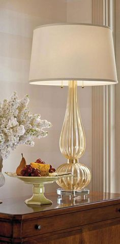 beautiful dining room setting with Venetian clear and gold Murano glass lamp; dining room decor ideas; decorating inspiration; Murano glass