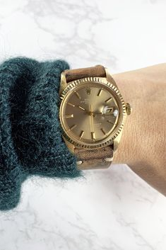 We love to add a fun strap to a classic and crisp Rolex oyster perpetual datejust watch. This taupe dial with 18K yellow gold case and fluted bezel pairs beautifully with this vintage hand-dyed leather strap. For more information, please contact us or visit our website. Oyster Perpetual Datejust, Signet Ring, Vintage Watches, Oysters, Michael Kors Watch, Gold Watch, Style Icons, Crisp, Watches For Men