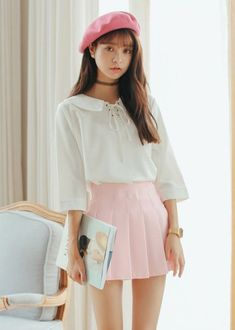 – A-line high waist pleated mini skirt  – Available in pastels or classic colors  – Japanese preppy school look  – Made from cotton spandex