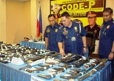 Chief PNP director general Alan Purisima (center) inspects the confiscated and recovered firearms. With him are PNP-8 regional director PCSupt Elmer Soria (left) and SSupt Edgar Basbas after the press conference at the Camp Ruperto Kangleon, Palo, Leyte held January 19.