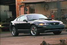 2001 Mustang Bullitt GT - In Ford offered a special version of its GT with the Bullitt nameplate. It was reminiscent of the 1968 390 fastback model driven by Steve McQueen in the 1968 movie Bullitt. 2001 Mustang Bullitt, 2001 Ford Mustang, Mustang Cars, Ford Mustangs, Detroit, New Edge Mustang, Used Car Prices, Derby Cars, Pony Car