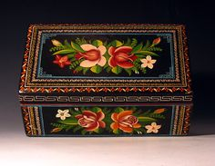 """Olinala box   dating to the 1940s. It's unique lacquer surface called """"""""Maque"""""""" was produced by mixing powdered pigments with the sap from a shrub that grows in the mountains of Michoacan. The name Olinala has dual significance, being the name of the wood from which    are carved or constructed and the town where an important market for these lacquered goods was located. This lacquer technique was first used by the Purepecha or Tarascan people who inhabited the area over 1000 years ago."""