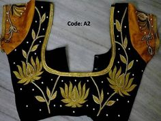 gold thread lotus design on a black blouse