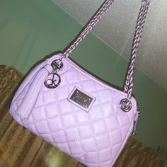 Calvin Klein quilted leather crossbody bag Gorgeous. New, never used. Leather. Lavender, pastel purple color.   Comes with leather care card.  Has Calvin Klein logo plaque and hanging charm plus leather tassel. Small size, about 10 inches wide fits a lot! Zipper compartment, zipper pocket and back flap pocket.  Adjustable strap can be worn cross body or doubled up over the shoulder.  Made in china No trades Calvin Klein Bags Crossbody Bags