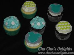 Chocolate and Vanilla cupcakes iced with cream cheese butter cream and fondant toppers. Dots, chevron, and onesie toppers made to match the decor at the party.