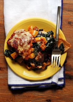 Spicy chipotle enchilada sauce brings bold flavor to this butternut squash and swiss chard enchilada casserole.
