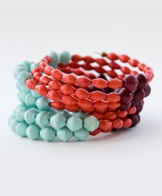 Handcrafted paper beads in fresh hues entwine around your wrist to add some brightness to your look.