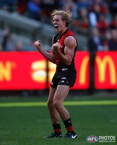 Darcy Parish of the Bombers celebrates a goal during the 2016 AFL Round 02 match between the Melbourne Demons and the Essendon Bombers at the Melbourne Cricket Ground, Melbourne on April 2, 2016.