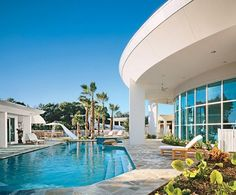 """""""I can't call it modern—it's really a mid-century-style home,"""" actor John Travolta says of the Florida house he shares with his wife, actress Kelly Preston."""