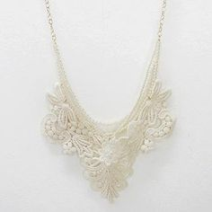 White and ivory lace necklace, Luphia by MK Kokoroni Ltd. // honestly, I don't know that I would ever wear this, but I think it looks neat