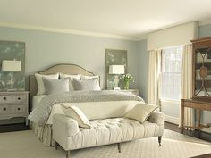 classic serene bedroom with sage green panels