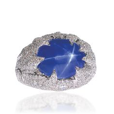 Lugano Diamonds, cabochon star sapphire and diamonds ring