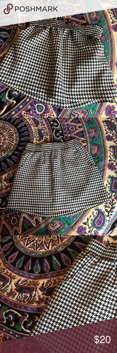 Twill black and white skirt Size small/medium. Stretchy waistband. Black and white patterned skirt. Super cute and versatile. The waistband can be folded over for a shorter mini style look! Skirts