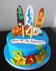 """Maybe this was for a surfer at Tynemouth, but this birthday cake certainly has a very Hawaiian theme with 3 surfboards and flowers from the island. Why is the music from """"Hawaii Five-O"""" running through my head suddenly? hawaiian surfboard birthday cake"""