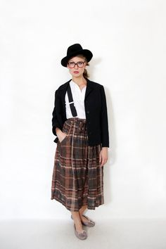 Love the way this vintage Georges Rech plaid brown midi skirt is styled.