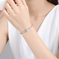 The crystal clear diamond in the middle just like a lover of the heart. It is surrounded by a round ring, which as the love from lover.How rare and beautiful it is to even exist. Love silver bracelet collection, cosmopolitan style for any occasion.