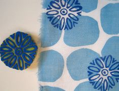 blue dot printed fabric with hand-carved stamp