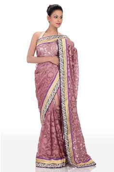 Get this self print saree now to spread the charm which is lasting & impressive at the same time. Its broad contrast border carries silver butties & golden lace. This designer piece is teamed with matching blouse that is adorned in a similar manner.