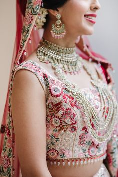 Indian Bride in Pink Traditional Dress with Gold Jewellery for Hindu Wedding | By Jessy Papasavva Photography | Hindu Wedding Ceremony | Pink Wedding Dress | Pink Veil | Pink Flowers for Wedding | Wedding Flower Arrangements | Indian Bride | Pink Wedding Colour Scheme | Bridal Jewellery | Bridal Accessories
